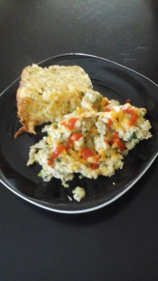 Scrambled eggs w/peppers, onions, scallions, cheese, sriracha. Side of jalapeno cheddar corn bread.