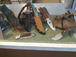 Now featuring Native American Knives, accompanied with belt loop leather sheaths. Wood and Deer Antler handles.